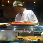 Watch the sushi chefs in action from the bag seats