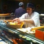 Beautiful sushi assortment in wooden boats.