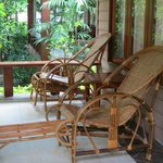 Great little attached balcony with two comfy wicker chairs.