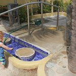Son earning his keep at the foot cleaning pool.