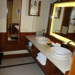 separate vanities from bathroom with toilet and shower