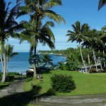 Idyllic grounds and landscaping right up to the white sand