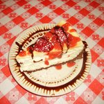 Cheese cake topped with fresh strawberries