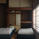 The dormitory-style room with Japanese tatami and futons