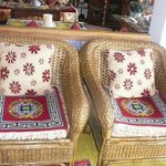 Comfy wicker chairs with handwoven pillows & cushions
