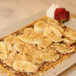 belgian chocolate crepe with banana and nuts