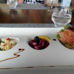 Presentation of food at restaurant by pool