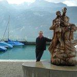 Myself next to a wooden sculpture in Brienz