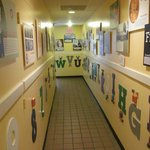 hallway to the Little C'Ville room, press the buttons and hear the letters and numbers names.