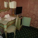dressing table and tv and minibar