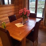 Dining area with lovely fresh flowers and a welcome letter.