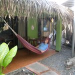 one of 6 cabinas with rocking chair, table, chairs and the hammock on each patio