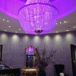 In the evening the lobby's chandelier shines violet making the place feel enchanted.