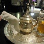 Mint tea, love the pink pon pon on the holder warmer,