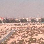 nearby empty desert with hazy skyline of downtown.