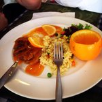 Tasty duck with orange jam and rice with vegetables.