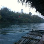 early in the morning, i saw a monk crossing the bridge
