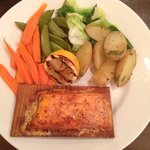 Salmon on a plank with boiled vegetables, very dry