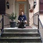 my husband a pooch inf ront of our room entrance