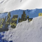 Painting  of the Chicago skyline on the breakwater on campus