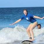 Me surfing with Chico coaching.