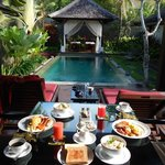 Delicious breakfast overlooking our private pool and massage tables