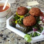 Greek Salad Topped with Falafel with a side of Tomato Soup