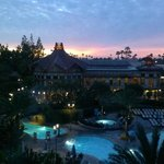 View of the pool and gorgeous sunset from our room