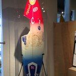 Bethany Hamilton's surf board with shark bite.