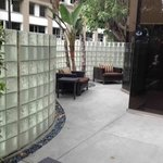 Outdoor patio. Liked the enclosed glass wall; safe
