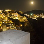 Oia at night from one side of balcony