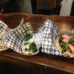 (Left to Right) Chilorio Brisket, Kale and Potato, and Porchetta tacos.