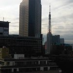 The Tokyo Tower is dwarfed by the Mori building