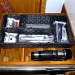 Combs, shavers, tooth brushes, etc. including torch light.