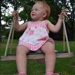 My daughter loved the swing under the massive trees.