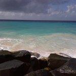Beach by the rocks.