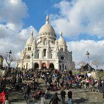 The sacre -coeur bathing in the early march sun.The stairwayss ful of local youngsters.