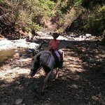 Crossing a picturesque stream on horseback