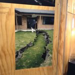 Photographing the photo on display of the earth opening up in a resident's garden