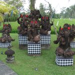 The grounds of the Hotel had Many Balinese statues from local culture and the flowers on the sta