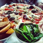 Great goats cheese pizza - look at those caper berries!