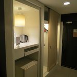 Entry area has all the conveniences, such as safe, fridge, coffee maker, etc