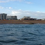 The View from out at sea! (its the long low brownish building on the beach)