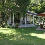 The house, its garden and veranda