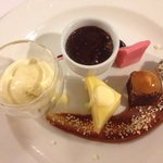 Assiette of desserts, creme brûlée,ice cream, lemon tart, Turkish delight, chocolate brownie and