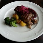 Grilled Horse Fillet Served with Potatoes, Greens & Red Wine Based Wildberry Sauce