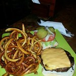 Hubby's big burger with homemade curly fries. Best burger on the island.