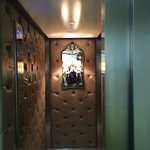 Ornate lighting and leather walls in the hotel lift