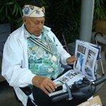 Pearl Harbor Survivor signing his picture - USS Arizona Memorial, Honolulu, Oahu, HI