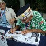 Pearl Harbor Survivor signing their pictures - USS Arizona Memorial, Honolulu, Oahu, HI